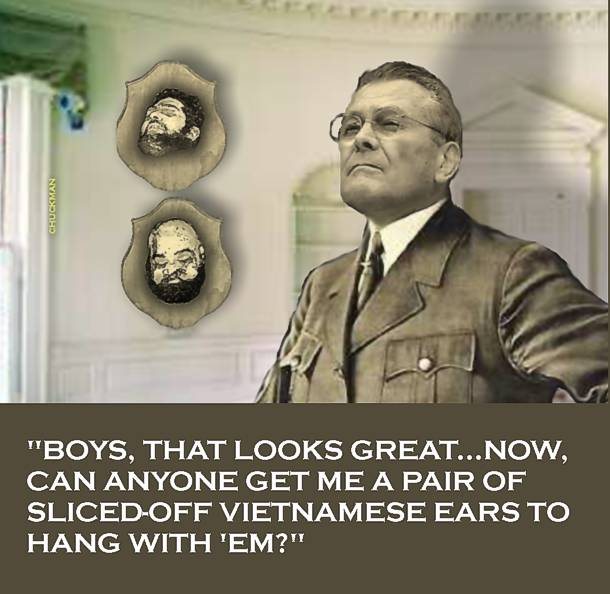 CHUCKMAN - RUMSFELD - WITH HEADS ON HIS OFFICE WALL.jpg