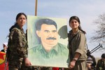 ybs_and_pkk_fighters_holding_up_a_painting_of_abdullah_c3b6calan.jpg