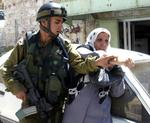 al_Khalil_162_August_29_2003_An_Israeli_soldier_aggressions_at_a_woman_Photo_by_Nayef_Hashlamoun.jpg