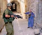 Israeli_Soldier_shooting_a_woman.jpg